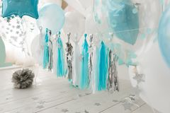 Baby birthday decorated room with white and blue balloons stock photo