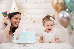 Free Baby Birthday Party. Mother And Her Daughter Celebrate And Fun Together. Child Party With Balloons Decoration And Cake Royalty Free Stock Image - 141429486