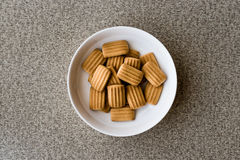 Baby biscuit in white bowl. Stock Photos