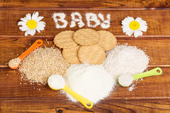 Baby biscuits made from three kinds of flour in  dark wood. Royalty Free Stock Image