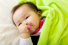Baby bite pacifier Stock Image