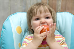 Baby is bite tomato Stock Photo