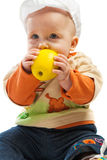 Baby biting apple Stock Photography