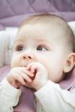Baby biting bagel Royalty Free Stock Image