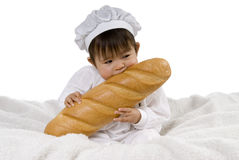 Baby biting baguette Stock Photos
