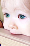 Baby Biting on Crib - Closeup Stock Photos