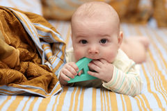 Baby biting letter Stock Photo