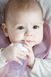 Baby biting pacifier Royalty Free Stock Image
