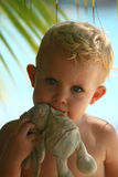 Baby biting rabbit Royalty Free Stock Photo