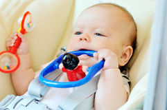 Baby biting toy Royalty Free Stock Photography