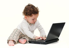Baby with black laptop Royalty Free Stock Images