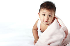 Baby Blanket. A baby with a quilt on a white background Royalty Free Stock Images