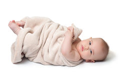 Baby with blanket Stock Images