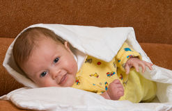 Baby in blanket Stock Photography