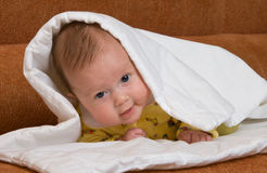 Baby in blanket Stock Photo