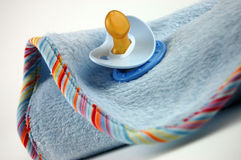 Baby Blanket and Pacifier Stock Photo