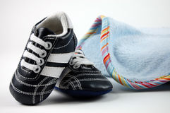 Baby Blanket and Shoes Stock Images