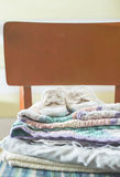 Baby blankets and shoes on chair Royalty Free Stock Photography