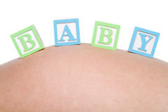 Baby Blocks. On pregnant belly Stock Photography