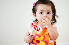 Baby with Blocks. A baby putting child blocks into her mouth with copy-space stock images