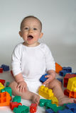 Baby Blocks. Image of cute baby playing with colorful building blocks royalty free stock photos