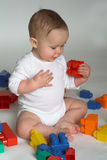 Baby Blocks. Image of cute baby playing with colorful building blocks royalty free stock photography