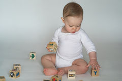Baby Blocks. Image of cute baby playing with alphabet blocks royalty free stock photography