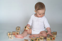 Baby Blocks. Image of cute baby playing with alphabet blocks royalty free stock photo