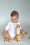 Baby Blocks. Image of cute baby playing with alphabet blocks Royalty Free Stock Photos