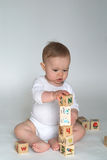 Baby Blocks. Image of cute baby playing with alphabet blocks Stock Photo