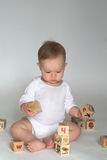 Baby Blocks. Image of cute baby playing with alphabet blocks Royalty Free Stock Images