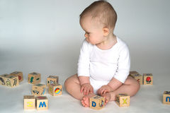 Baby Blocks. Image of cute baby playing with alphabet blocks Royalty Free Stock Image