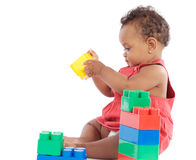 Baby with blocks. Adorable baby girl playing with building blocks royalty free stock photography