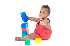 Baby with blocks. Adorable baby girl playing with building blocks royalty free stock image