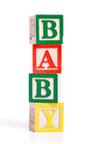 BABY blocks. A stack oif children's alphabet blocks spelling the word 'BABY' on a white background Stock Photography