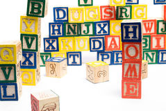 Baby Blocks Home. The word home made of assorted colors of baby blocks, with other blocks in the background stock photos