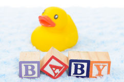 Baby blocks spelling baby. And a rubber duck Royalty Free Stock Photo