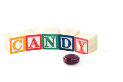 Baby blocks spelling candy. Isolated on a white background Stock Image