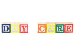 Baby blocks spelling day care. Isolated on a white background Royalty Free Stock Images