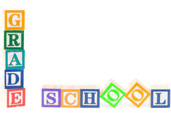 Baby blocks spelling grade school. Isolated on white background Royalty Free Stock Photo