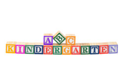 Baby blocks spelling Kindergarten. Isolated on a white background Royalty Free Stock Images