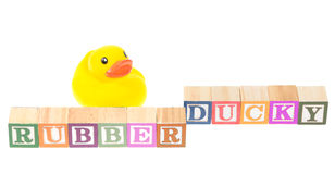 Baby blocks spelling rubber ducky and a rubber duck. Baby blocks spelling rubber ducky with a rubber duck. Isolated on a white background Stock Photo