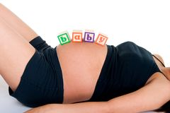 Baby Blocks On Stomach Stock Photo