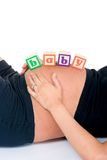 Baby Blocks On Stomach Royalty Free Stock Photography