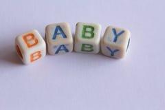 Baby in Blokletters Stock Afbeeldingen