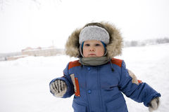 Baby blond boy winter outdoors Stock Photography