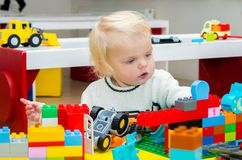 Baby girl playing with building blocks Royalty Free Stock Image