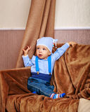Baby blouse and jeans with suspenders Royalty Free Stock Images