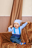 Baby blouse and jeans with suspenders Stock Image