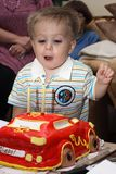 Baby blowing out the candles stock photo